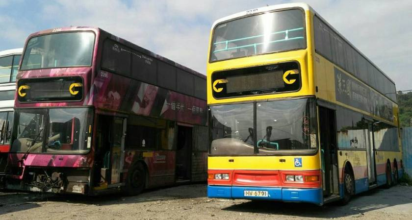 a pair of duple metsec bodied dennis tridents in a hong kong scrap yard.jpg